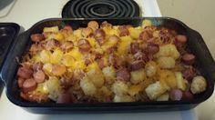 Tater Tot Chilli hot Dog Casserole with cheese - White trash party food.   Made this for a white trash party and it was delicious! I will def make again for us at home. Pro tip: cook tater tots before following recipe. Used frozen tots and it took forever to cook through - way longer than 20 min