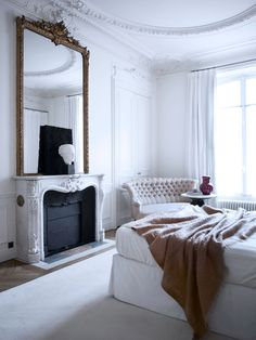 .giant mirror above mantel.