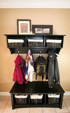 "Entry way organization; LOVE THIS!!!!! What a great way to give everyone a place to ""drop their stuff"" instead of a kitchen counter or floor near the door"