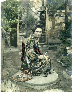 Elise Ladew Grace dressed as a geisha. This image had been very carefully hand tinted, circa 1918.