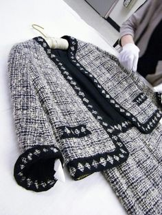 The famous Chanel suit (vintage above) will forever remain a staple item in a chic, fashion lover's closet. Inherent constraints: Must have lining, pockets, heavier material for jacket and buttons. Imposed constraints: tweed material, signature braided trim, color preference, gold buttons and size.