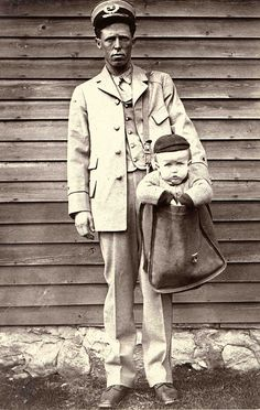 From the archives of the National Postal Museum comes this photo of a postal carrier with a young boy in his mailbag. After parcel post service was introduced in 1913, at least two children were sent by the service. With stamps attached to their clothing, the children rode with railway and city carriers to their destination. The Postmaster General quickly issued a regulation forbidding the sending of children in the mail after hearing of those examples.