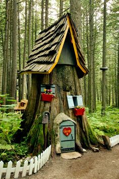 Tree stump fairy home with window boxes. I'd plant real tiny flowers in the boxes. Maybe use painted bird cage feeders that hook on.