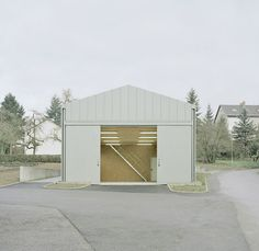 """Situated in the Odenwald low mountain range, the Hangar XS is a maintenance garage and storage building adjacent to the """"The sun garden"""" - which is a Black Architecture, Contemporary Architecture, Germany Area, Mini Loft, Building Sketch, Shade Structure, Tiny House Cabin, Simple Interior, Built In Storage"""
