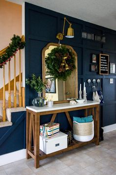 Welcome to our navy entryway all decked out for Christmas! Come take the tour of this tiny entry and see how I decorated it for the holidays in less than 10 minutes. Lots of simple Christmas decor ideas! #christmasdecor #holidaydecor