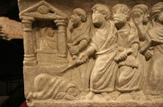 This carved tablet shows the stronger more put together Romans, preparing to kill a human like creature depicting a weak catholic. The carving is in favor of the Romans showing their power.