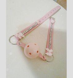 pink. ball gag. leather. bows. rhinestones.