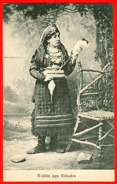Albanian Spinner using a high whorl spindle and distaff