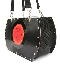 One side of the purse features the actual vinyl record, with the cover art on the reverse.