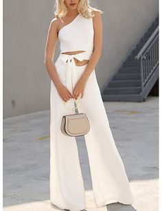 This elegant jumpsuit has a trendy cutout in the middle. It's a one-shoulder style with a bow at the waist. The wide leg style is ultra chic.