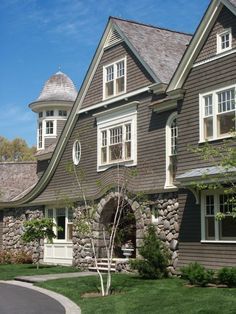 beautiful home with great architectural features.  stone, arches, turret and shingles.  LOVE