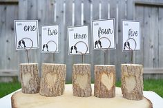 Table numbers - How Nice! Wouldn't these be nice to have a basket of them at the door for a favor the guest could take home ! and Plain except maybe have the wedding couples name date printed stamped on bottom _ but cute on the ones for the tables to add first letter of each name carved in the hearts | C + M | for the bride to keep.