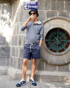J.Crew men's henley hoodie in navy stripe, dock short in garment-dyed chino, Japanese cotton bucket hat in indigo, Sam sunglasses and New Balance® for J.Crew 998 midnight moon sneakers.