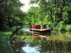 Lazily cruise the waterways in a narrow boat