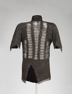 15th c. Western Iranian or Anatolian mail and plate armor back view, steel engraved and inlaid with silver - Met Museum 36.25.54