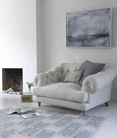 Bagsie love seat is priced from £1,295, Bergen rug £295