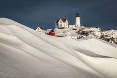 Nubble #Lighthouse on Cape Neddick in #Maine, covered by a blanket of snow by Benjamin Williamson - http://dennisharper.lnf.com/