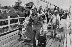 About 600 foreigners and Cambodians sheltered at the French embassy arrive by bus in Arayaprathet 04 May 1975. On New Year's Day 1975, Communist troops led by Pol Pot and Ieng Sary, launched an offensive to oust Lon Nol's Khmer Republic. The Lon Nol governement in Phom Penh surrendered 17 April 1975 after 117 days of the hardest fighting of the war. Immediately after its victory, the PCK ordered the evacuation of all cities and towns. Many of the foreigners and some Cambodians, who couldn't…