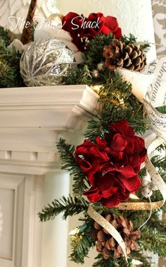 The Fancy Shack | beautiful Christmas garland draped over the Mantle.