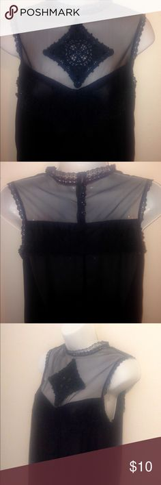 High Neck Black Sheer Top w/Neck Button Closure Sexy and different! Size is medium. I get compliments all day long when I wear this top! See You Monday Tops