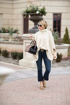 Seersucker and Saddles. White knit poncho+flare cropped jeans+leopard print loafers+black belt with golden details+black and leopard print handbag+sunglasses. Fall Casual Outfit 2016