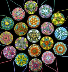 These are some of the first kaleidoscope pendants I (Carol Simmons) made for sale using the technique I now teach. The backs and fronts have different designs.