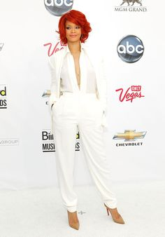 Rihanna Pantsuit - Rihanna opted for a minimalist look at the Billboard Music Awards in a white hot Max Azria suit. Her loosely curled red bob gave color to the look, while pointy nude Christian Louboutin stilettos maintained her streamlined silhouette.