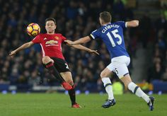Ander Herrera of Manchester United in action with Tom Cleverley of Everton during the Premier League match between Everton and Manchester United at...