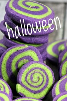 Love these spooky pinwheel cookies for Halloween! Make Halloween pinwheel cookies for a fun and color way to celebrate! Halloween cookies are a fun alternative to candy! Cute and easy, they're great for spooky or cute Halloween party desserts. Try this easy recipe! #halloweencookies #pinwheels