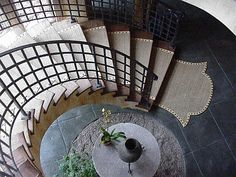 Beautiful railing and carpet runner. Great article on nailheads on this link also.