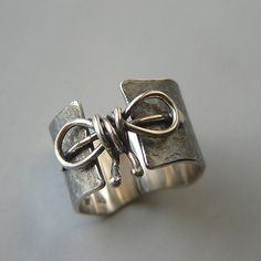 https://www.etsy.com/listing/272125300/sterling-silver-ring-silver-oxidized-bow?ref=shop_home_active_4
