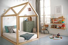 A house-framed floor bed in a Montessori-Inspired Toddler Room - Photo via RockRoseWine. Learn how to create a safe and educational Montessori bedroom or nursery for your little one using these simple tips. Big Girl Rooms, Boy Room, Kids Rooms, Child's Room, Toddler Rooms, Room Kids, Small Rooms, Cool Beds For Kids, Montessori Bedroom