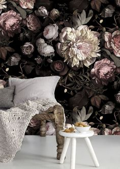 A dark floral wallpaper is such a timeless choice for a bachelorette's living space, and even for young couples!