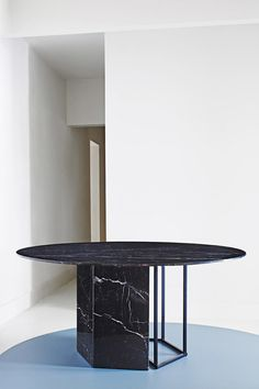Plinto by Meridiani Editions is a series of sleek bronze, wood, and marble tables designed by Andrea Parisio.