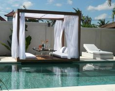 Fascinating Semi Inground Pools To Inspire Your Exterior Ideas: Exterior Outdoor Gazebo With White Curtain Decoration And Semi Inground Pools For Beautiful Backyard Landscaping Design