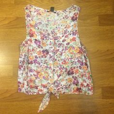 Floral button tie tank top Originally from forever 21! worn once or twice. There are buttons going down the middle of the shirt and a tie on the bottom which can be undone. Forever 21 Tops Tank Tops