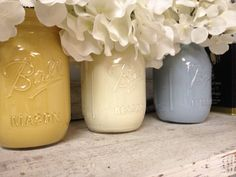 Hand-painted Yellow, White, and Light Blue Mason Jars. Perfect for Gifts, Home Decorations, and Weddings.
