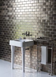 Sophisticated bathroom style - 600mm basin with overflow & ceramic console legs from Arcade Bathrooms. http://www.arcadebathrooms.com/Products/ProductDetail?prodId=80036&name=600mm%20basin%20with%20overflow%20%26%20ceramic%20console%20legs%20