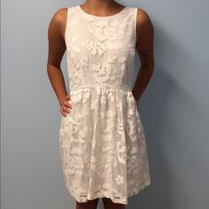 NWOT Sheer Floral Lace Dress NWOT Floral lace dress with sheer mesh back. It has a side zipper as well for easy fitting. Size small and fits to true to size. Forever 21 Dresses