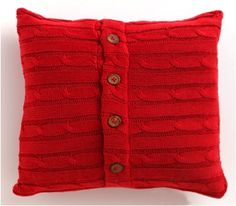 Home is where the heart is with the Cable Knit Pillow in red. Available at a Sofa Mart near you.