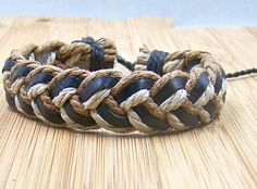 Fashion men's women's leather cuff wristband with brown and white cotton Rope Bracelet. $3.50, via Etsy.