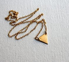 This perfect little necklace features a small brass triangle on a 16 inch yellow 14k gold-fill chain. Goes great with any outfit! Handmade