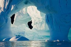 The massive columns and arches of an iceberg in the Denmark Strait, just off the east coast of Greenland