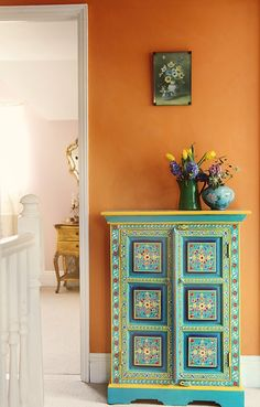 Barcelona Orange wall. / painted chest More