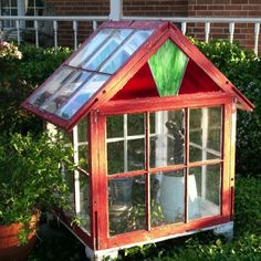 Love this tiny greenhouse/terrarium made from recycled windows