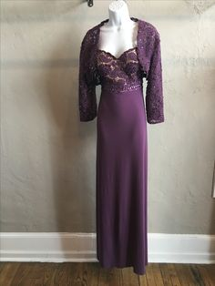 Pictured in Dusty Lavender. Available in 2 other colors. Chiffon with matching bead work on top. Comes with a jacket.