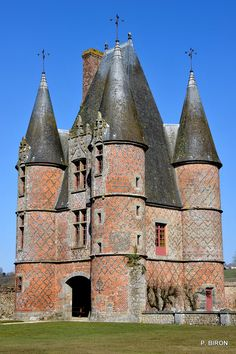 The Châtelet du Château de Carrouges in Normandy, France, is unusual in its combination of an austere fortress with a comfortable residence.   It was built partly in the 14th and partly in the 15th centuries.