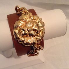 Lion Face Wrap Bracelet NWOT Lion face wrap bracelet. Adjustable. Faux leather. Jewelry Bracelets
