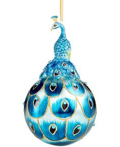 """You'll be as proud as a peacock to have this ornament hanging on your tree for Christmas! Glass, polyresin Imported 6"""" hanging ornament Hangs from gold cord loop hanger Wipe clean"""