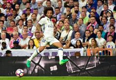 Real Madrid's Brazilian defender Marcelo controls a ball during the Spanish league Clasico football match Real Madrid CF vs FC Barcelona at the Santiago Bernabeu stadium in Madrid on April 23, 2017..Barcelona won 3-2. / AFP PHOTO / GERARD JULIEN